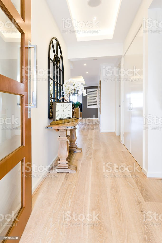 Hallway to a modern house with wooden floor stock photo