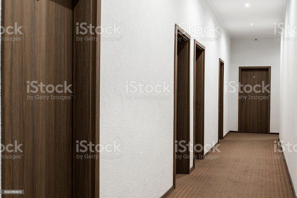 hallway with closed doors stock photo