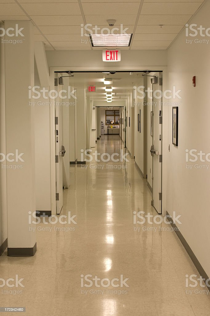 hallway with two exit signs royalty-free stock photo