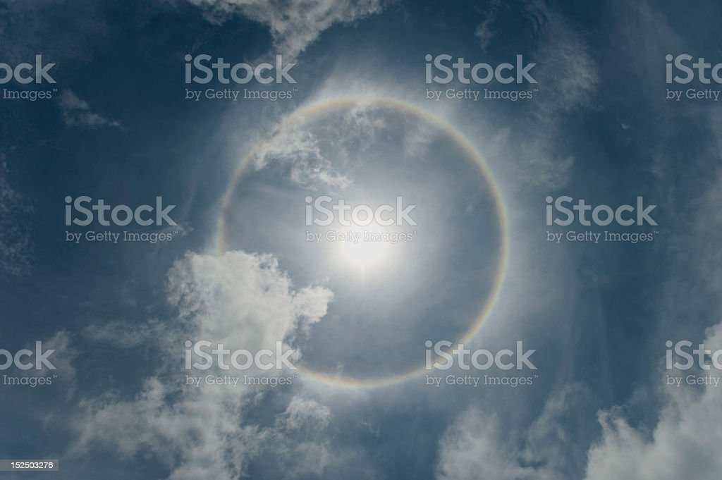 Halo around the sun on a cloudy sky stock photo