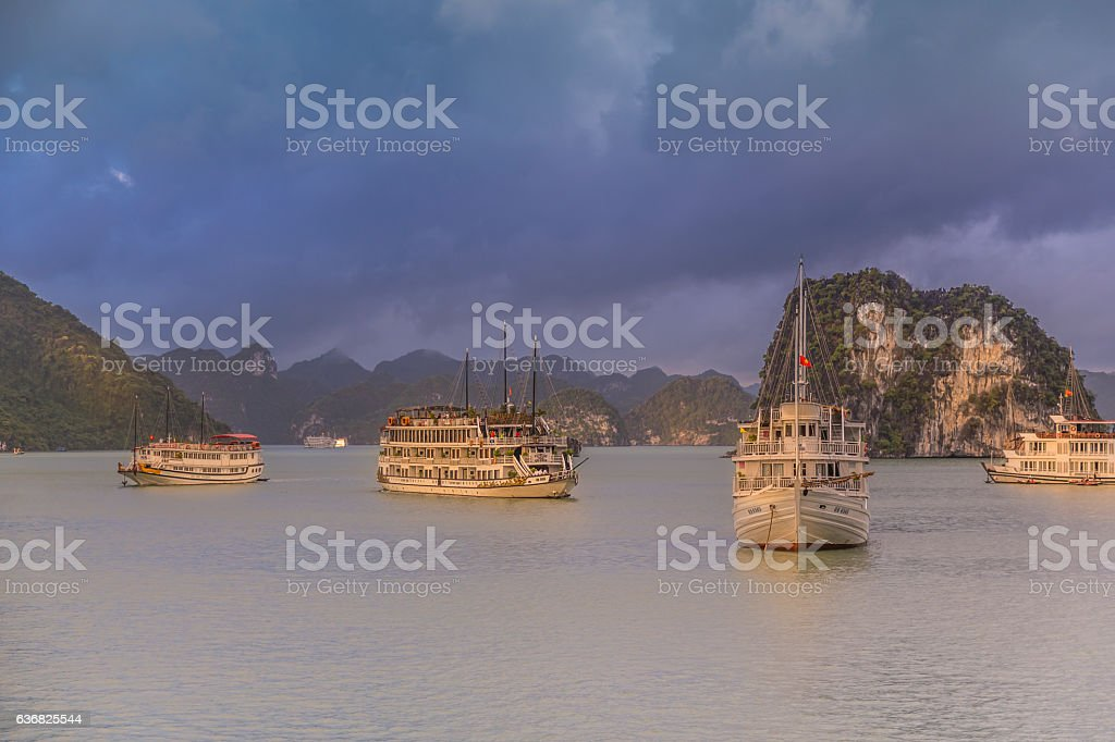 Halong bay Vietnam tourist ship stock photo