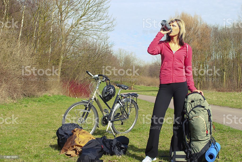 Halting girl with a bicycle royalty-free stock photo