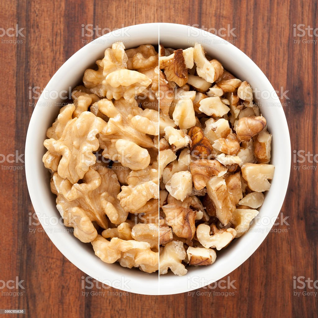 Halved and chopped walnuts composition stock photo