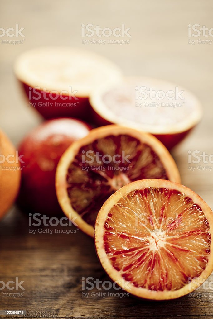 Halved blood orange with hints of red and orange stock photo