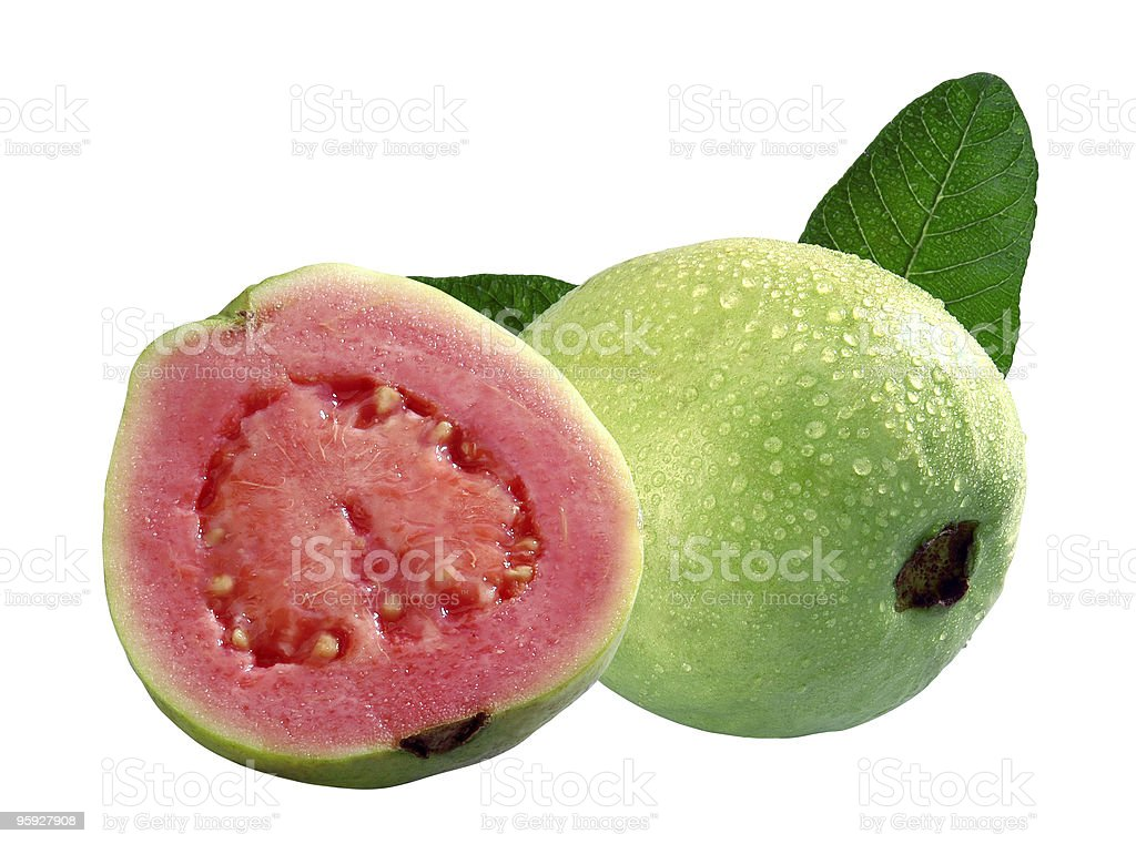 Halved guava beside whole one against white background stock photo