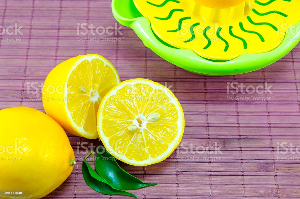 Halved lemons and a colander royalty-free stock photo