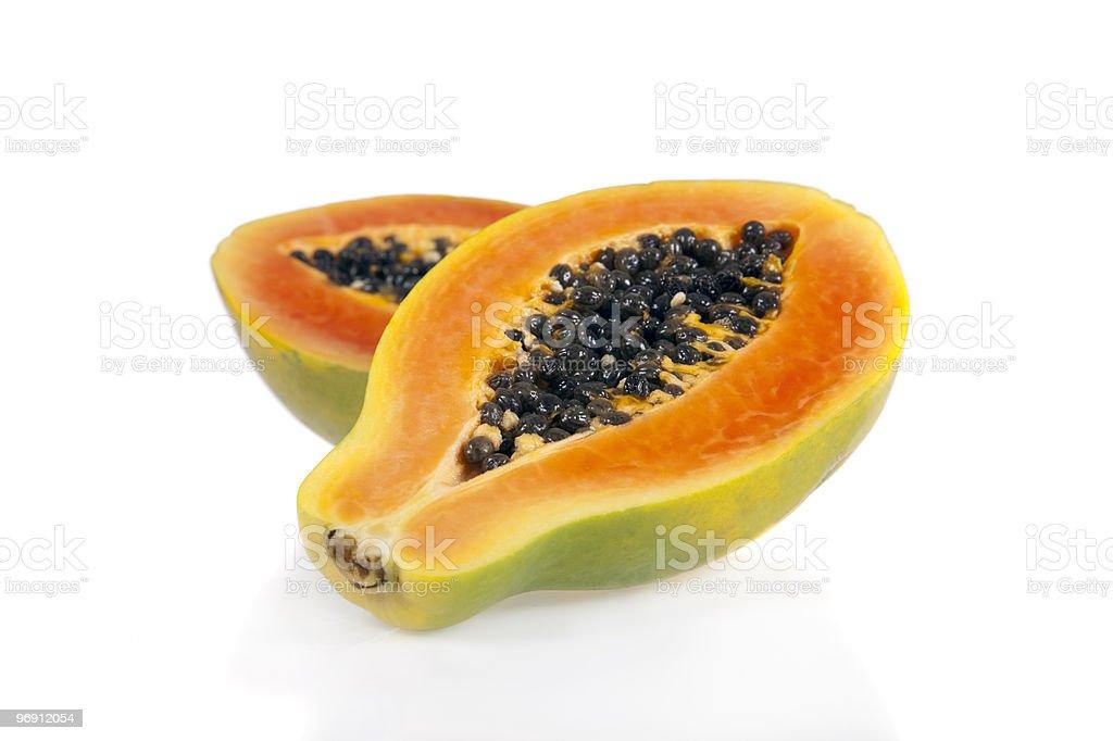 Halved papaya isolated on white background stock photo