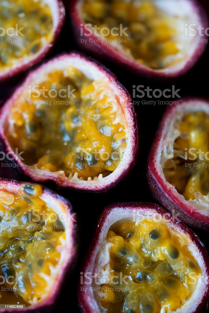 Halved passion fruits showing the insides and skin edges royalty-free stock photo
