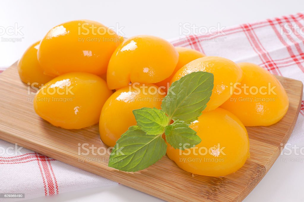 Halves of peeled peaches stock photo
