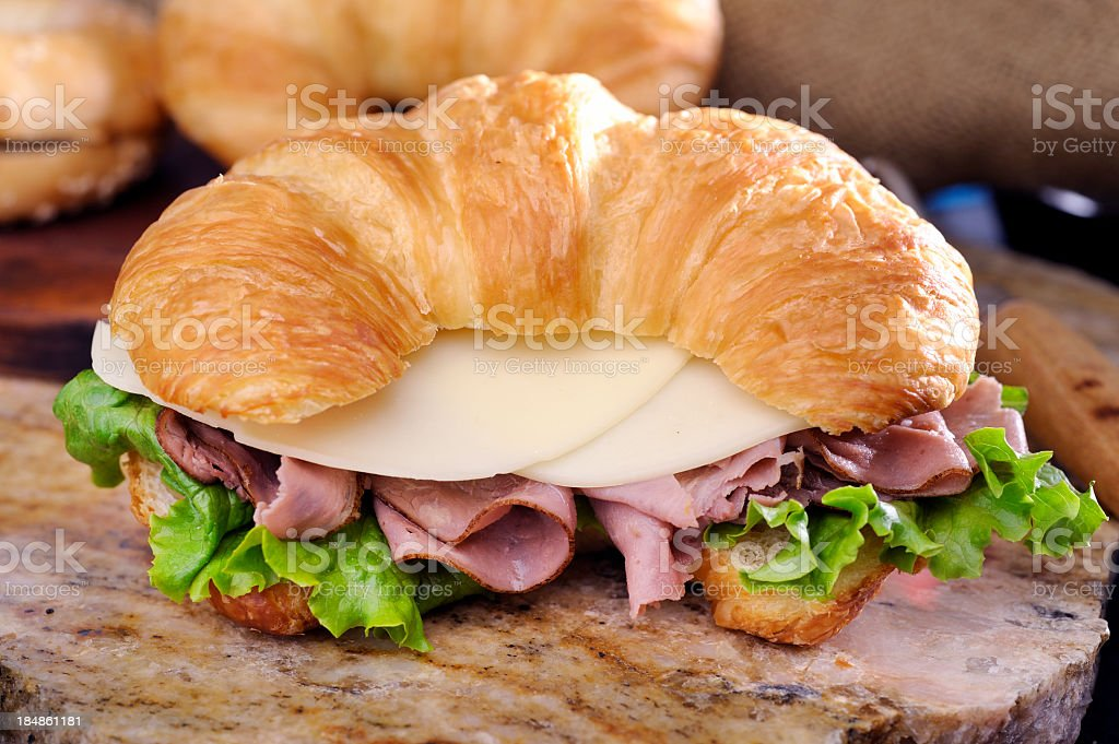 A ham and cheese sandwich on a croissant stock photo