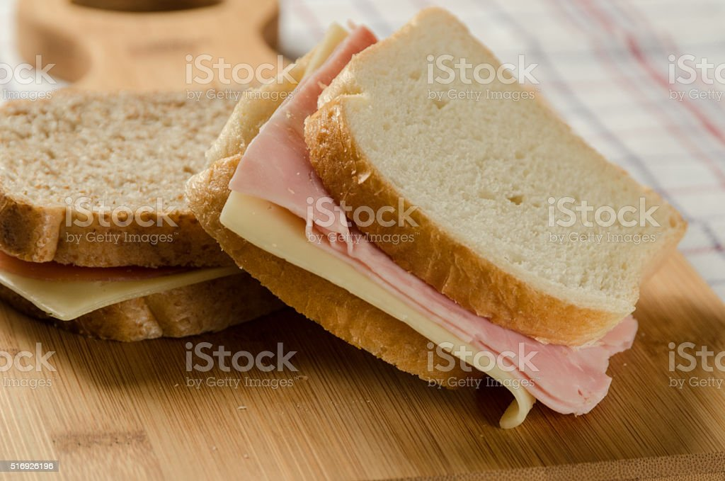 Ham and Cheese Sandwiches with both White and Wholemeal Bread stock photo
