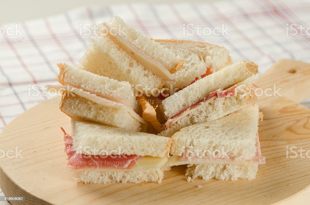 Ham and Cheese Small Sandwiches on the Cutting Board stock photo