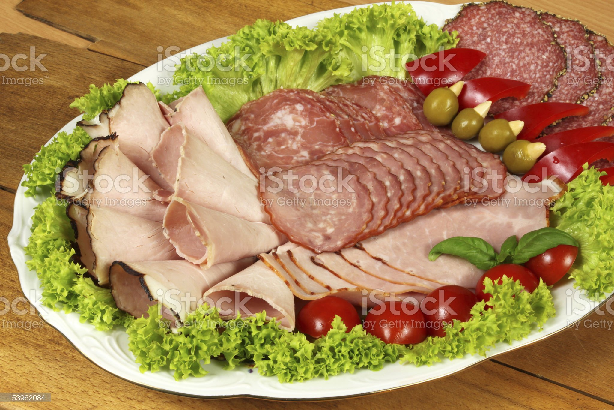 Ham and sausage on banquet dish royalty-free stock photo