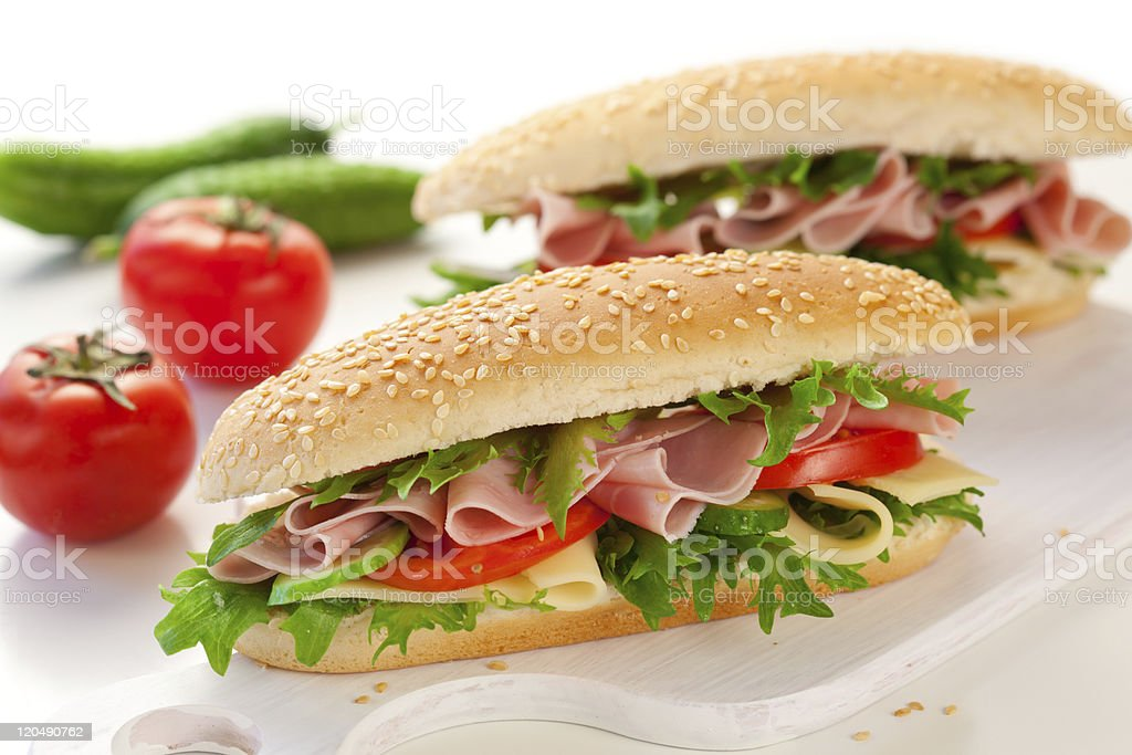Ham cheese and tomato sub sandwiches royalty-free stock photo