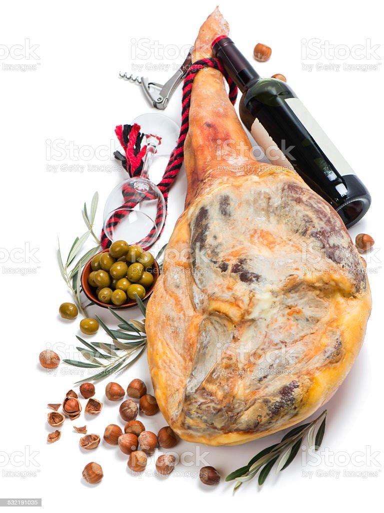Ham, olives, wine and hazelnuts stock photo