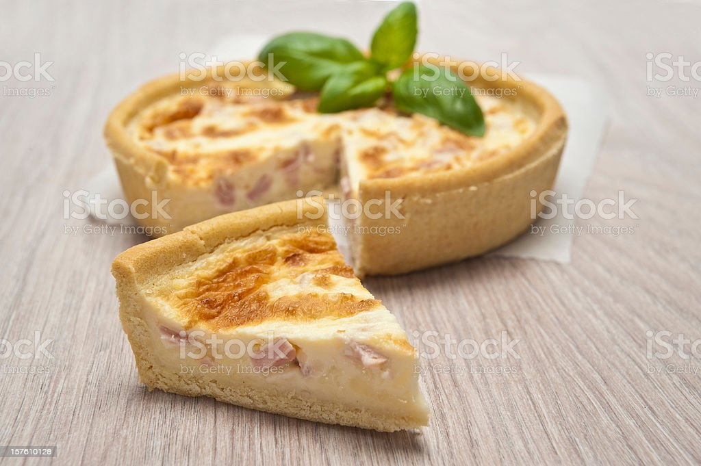 Ham quiche with a piece of the pie cut out royalty-free stock photo