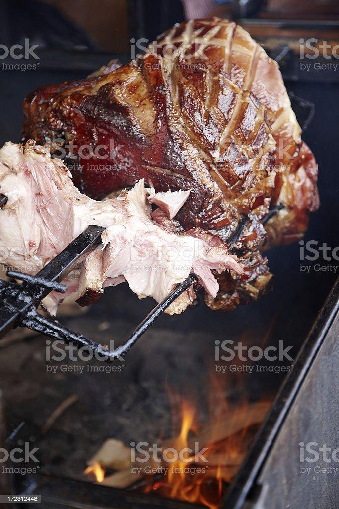 Ham roast on the spit stock photo