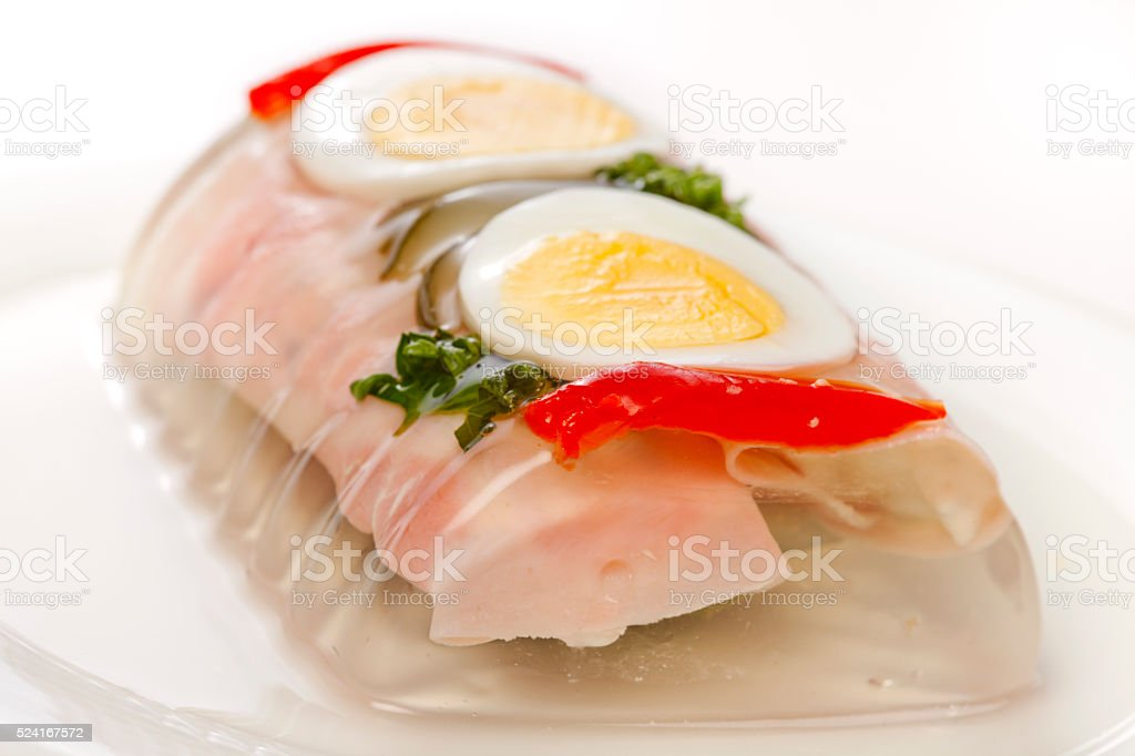 Ham roll in aspic on plate stock photo