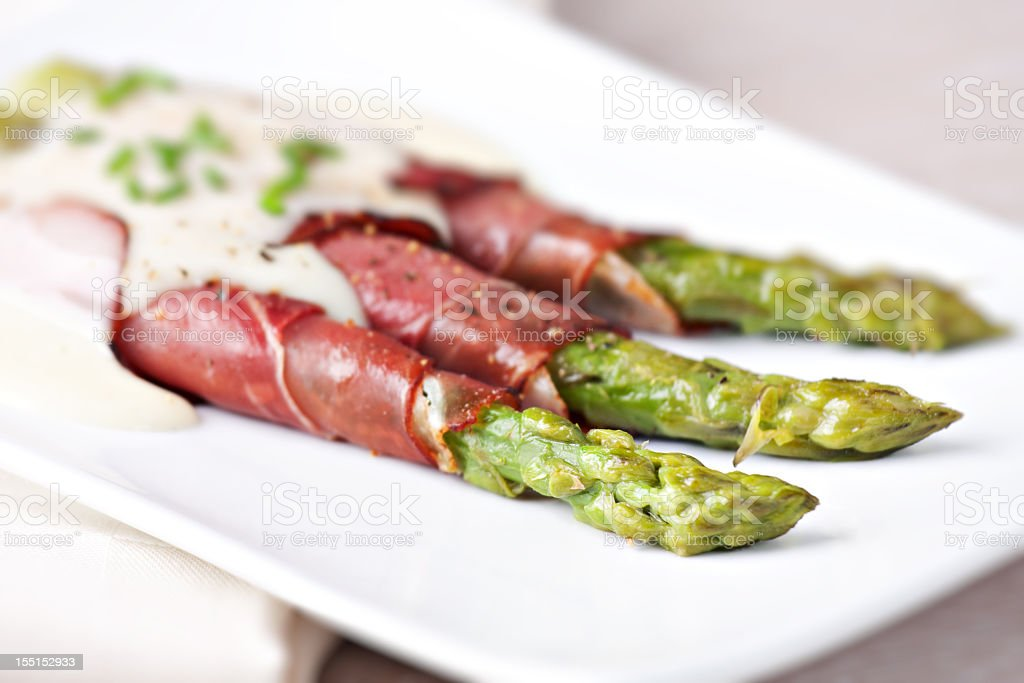 Ham rolls with asparagus and bechamel stock photo