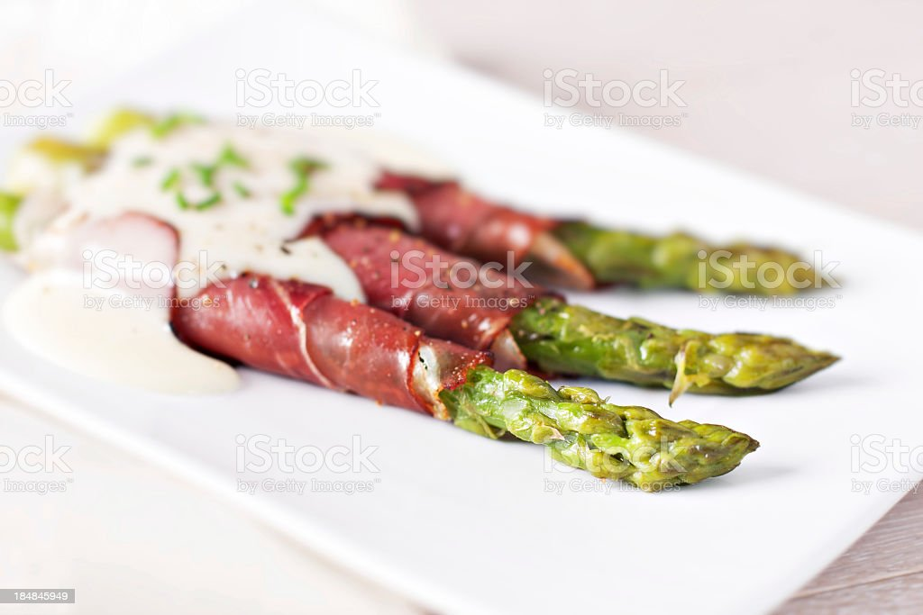 Ham rolls with asparagus and bechamel royalty-free stock photo