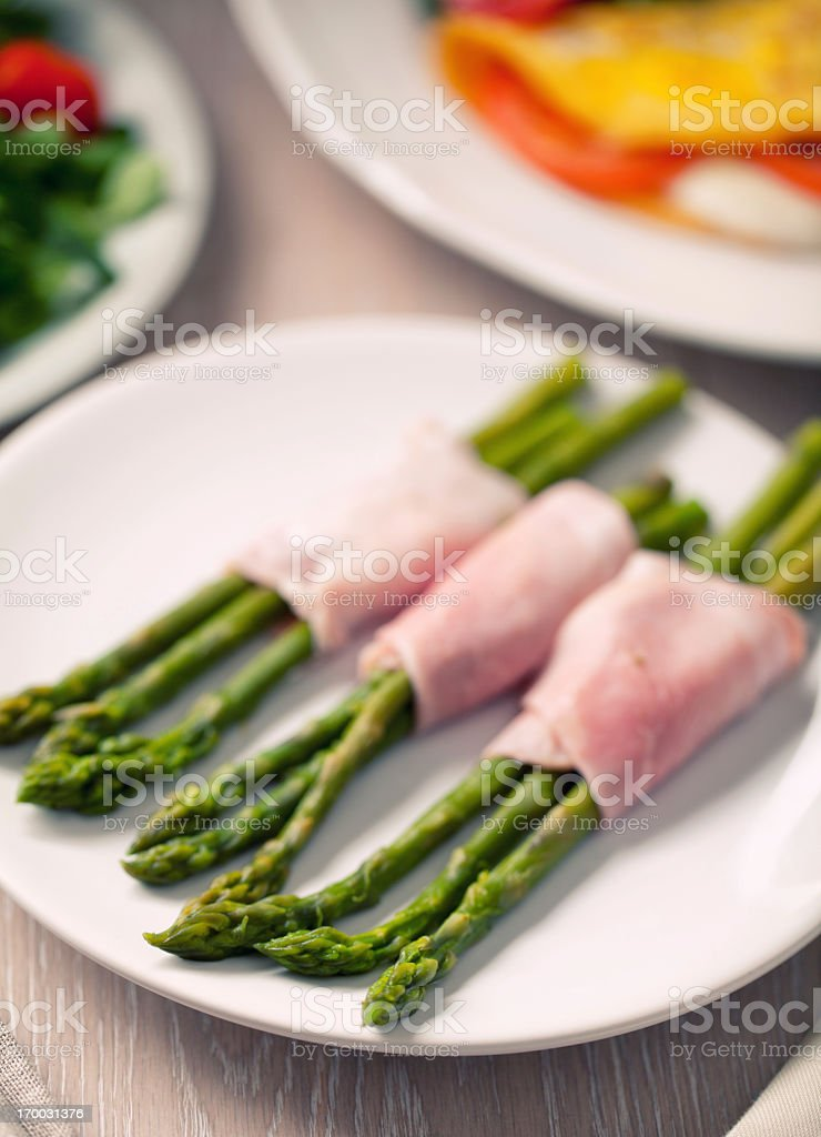 Ham rolls with asparagus stock photo