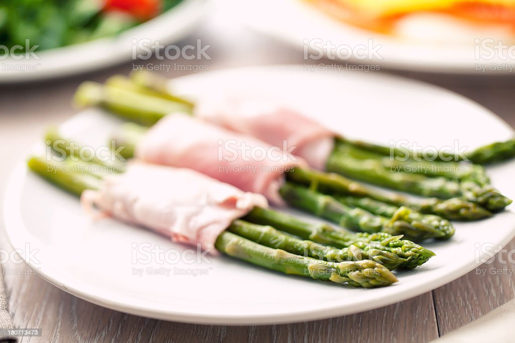 Ham rolls with asparagus stock photo