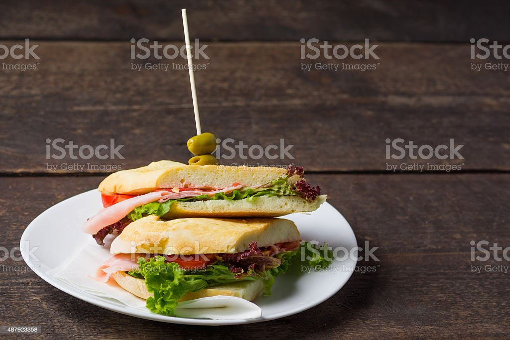 Ham Sandwich on a wooden table royalty-free stock photo