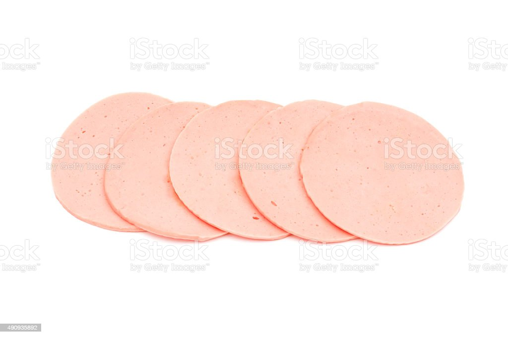 ham sausage or rolled bologna slices isolated on white backgroun stock photo