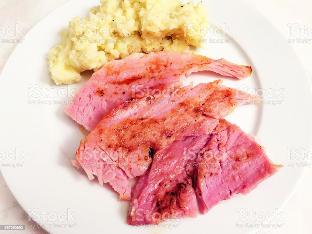 Ham With Mashed Potatoes and Pan Dripping Gravy stock photo