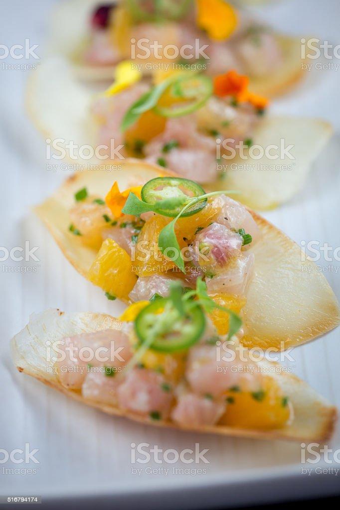 Hamachi Nachos.  Yucca chips, citrus, micro cilantro stock photo
