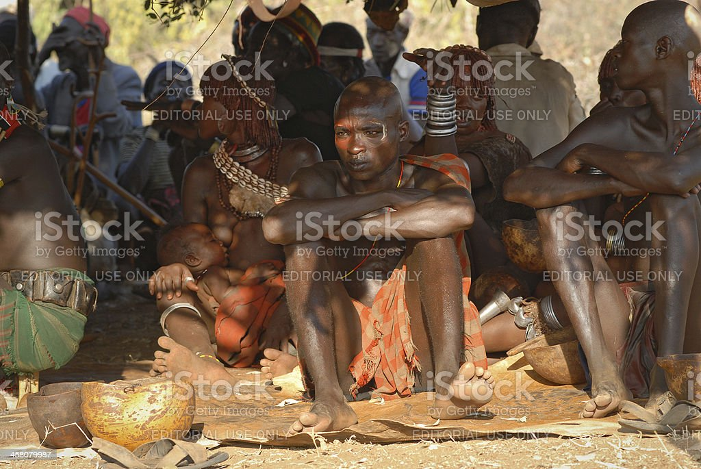 Hamar people resting during bull jumping ceremony, Ethiopia royalty-free stock photo