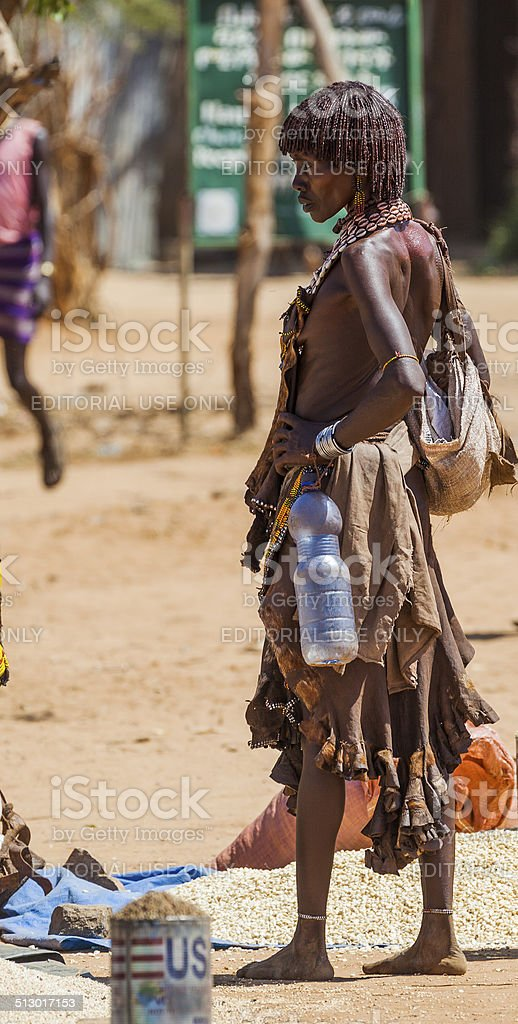 Hamar woman seller at village market. stock photo