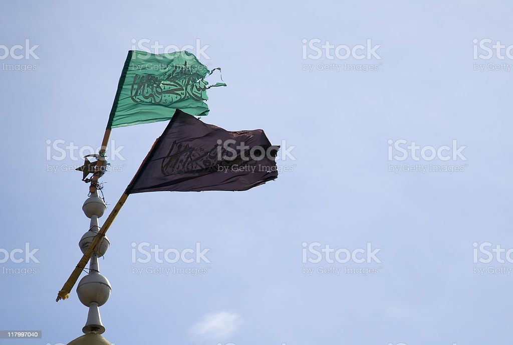 Hamas Flags at top of mosque stock photo