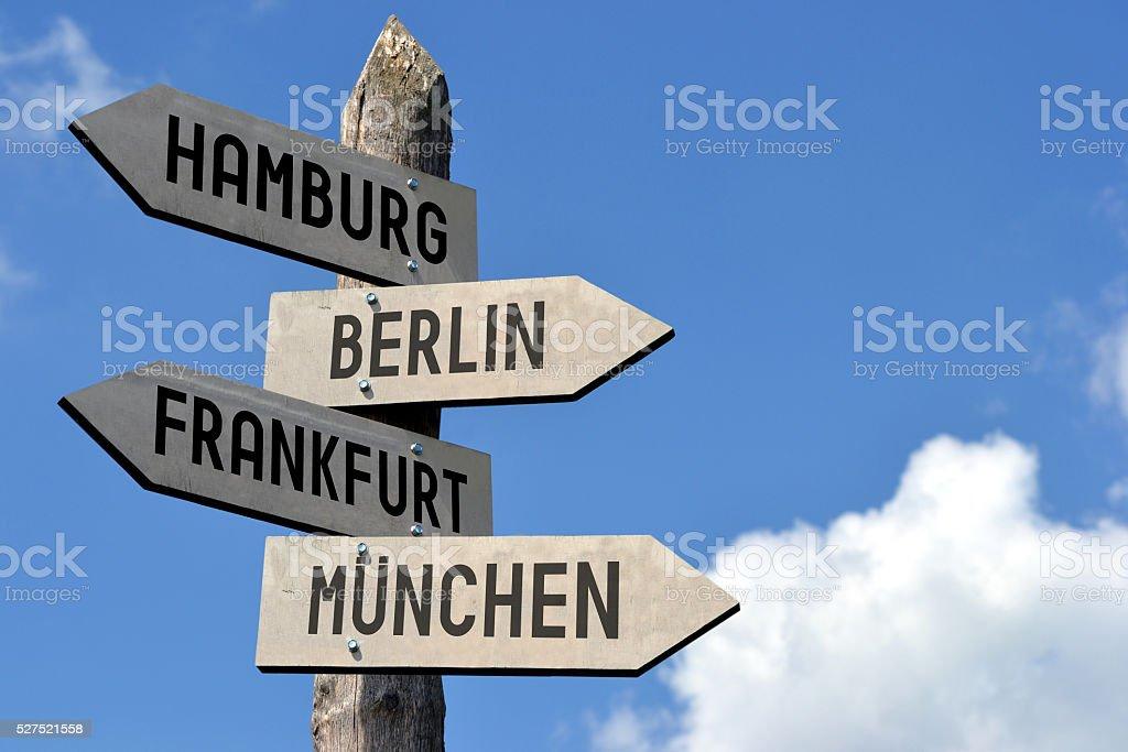 Hamburg, Berlin, Frankfurt, Munchen - signpost stock photo