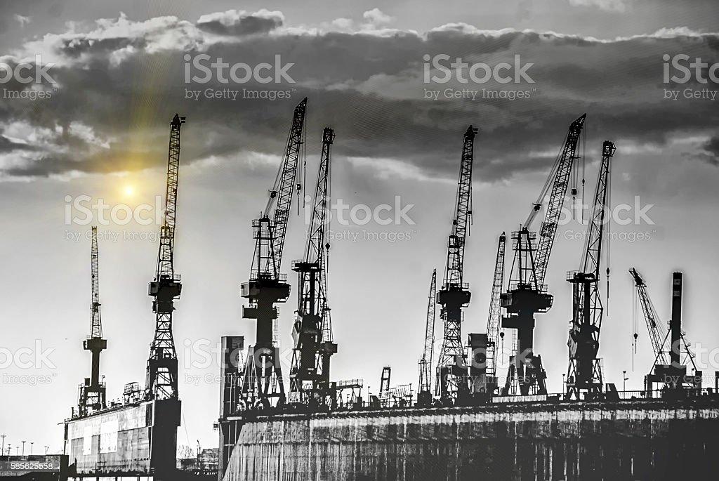 Hamburg harbor cranes stock photo