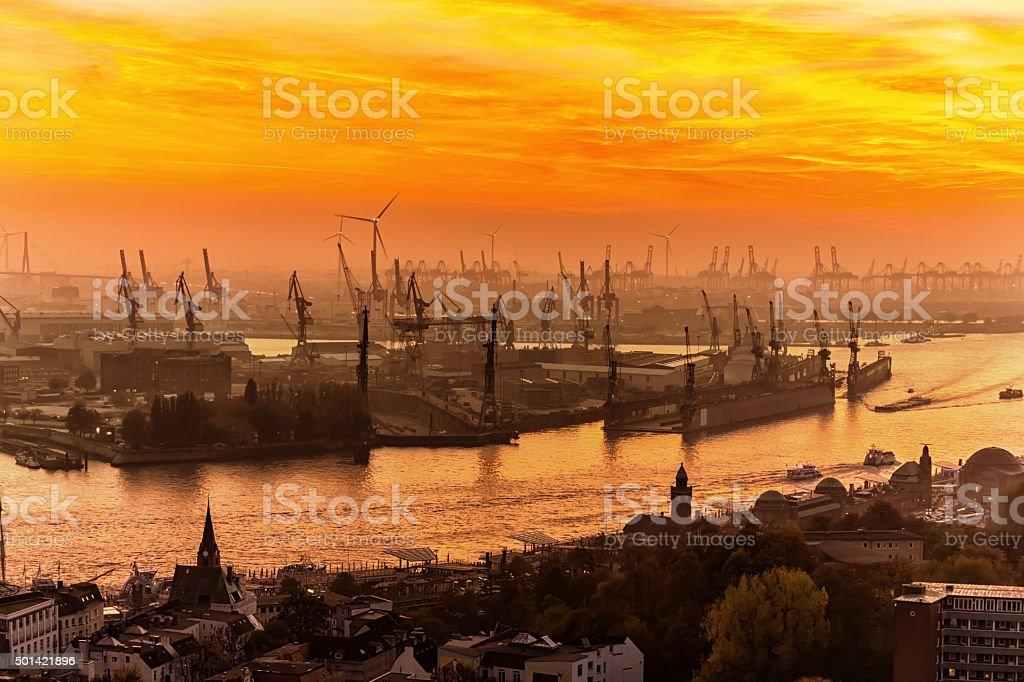 Hamburg Industrial Harbor at sunset stock photo
