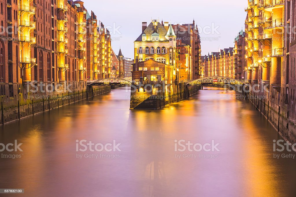 Hamburg old city warehouse long exposure shot at dusk stock photo