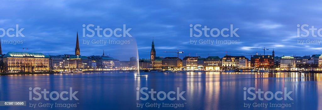 Hamburg skyline and fountain in the Lake Binnenalster stock photo