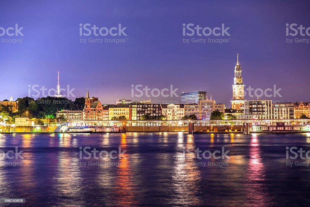 Hamburg skyline with Landungsbrücken and Church Michel stock photo