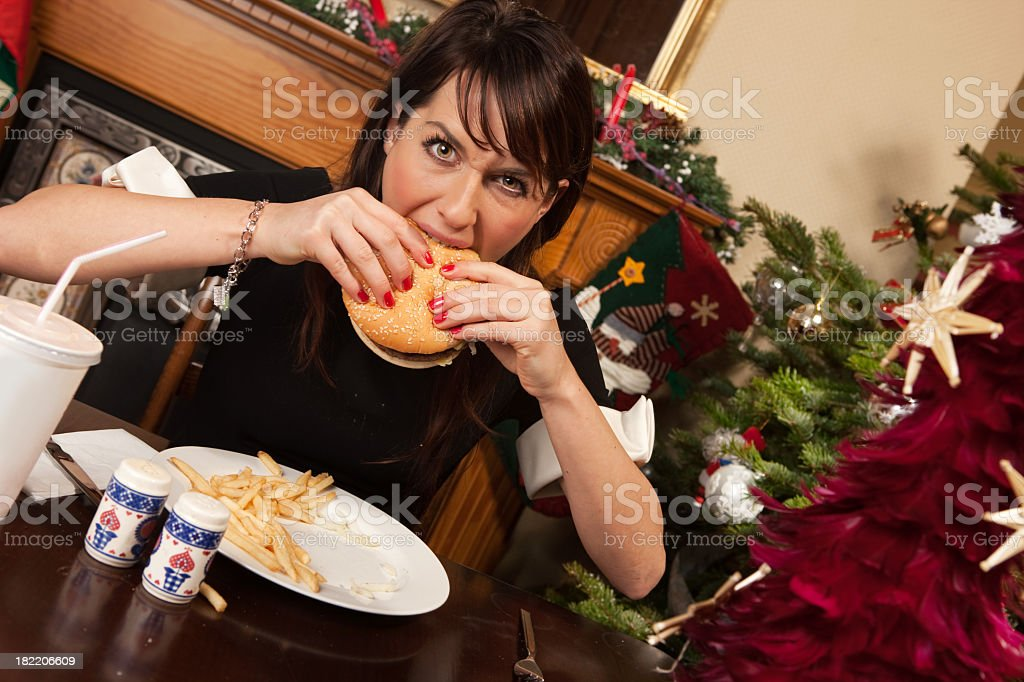 Hamburger and chips as Christmas dinner stock photo