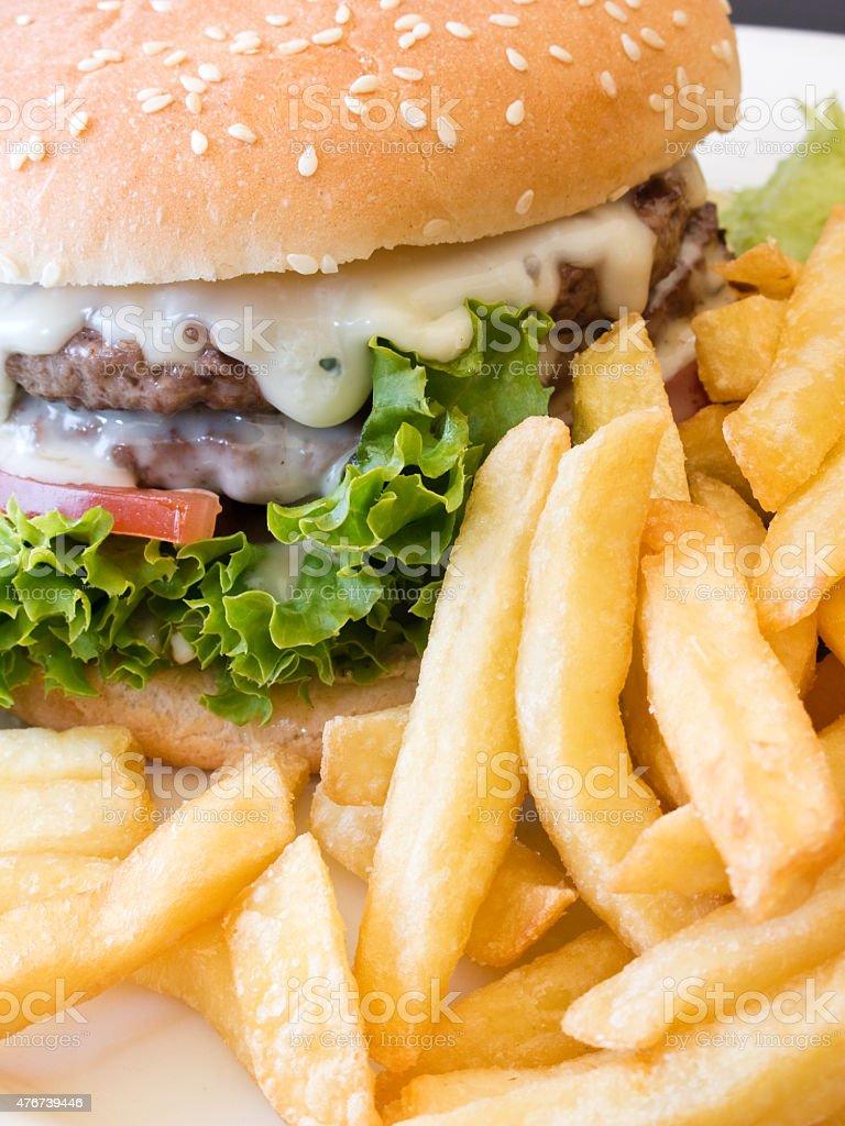 Hamburger and potato chips stock photo