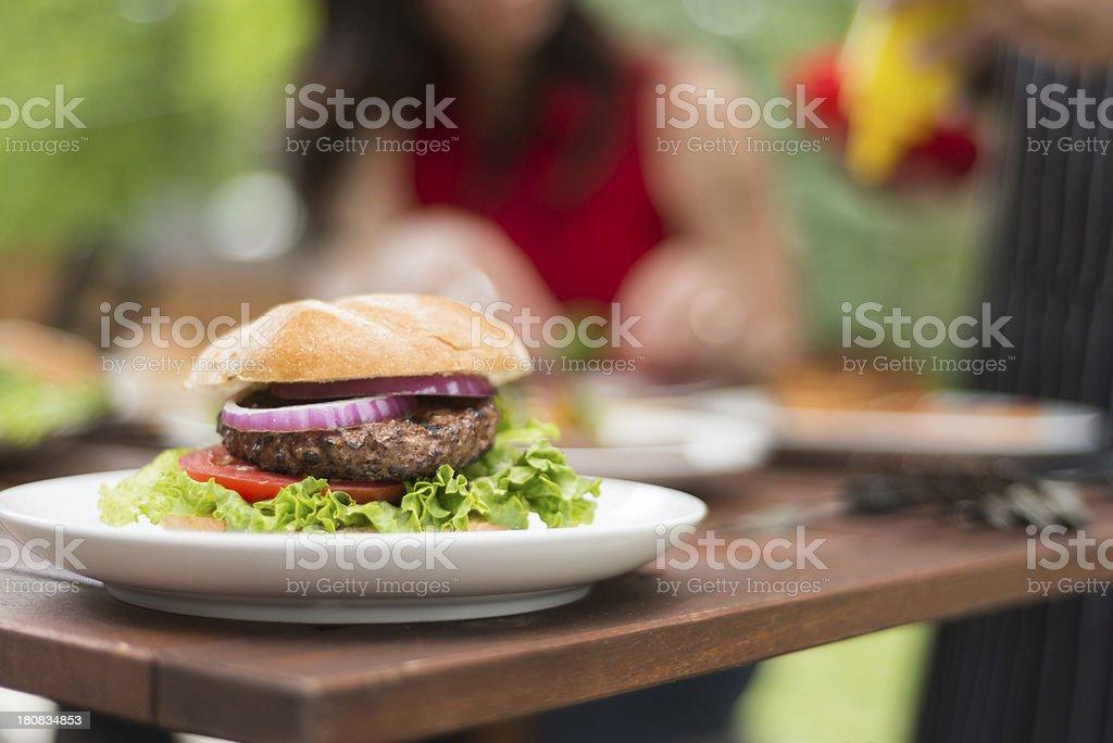 Hamburger at BBQ royalty-free stock photo