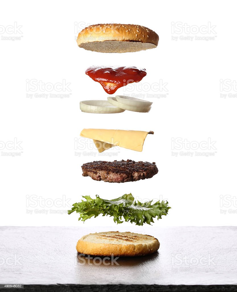 Hamburger decomposed into prime factors on a white background stock photo