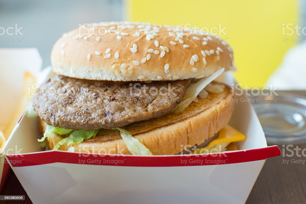 Hamburger in white paper box in fast food stock photo