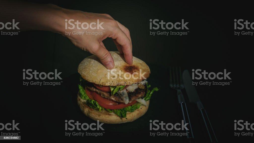 Hamburger on the grill stock photo