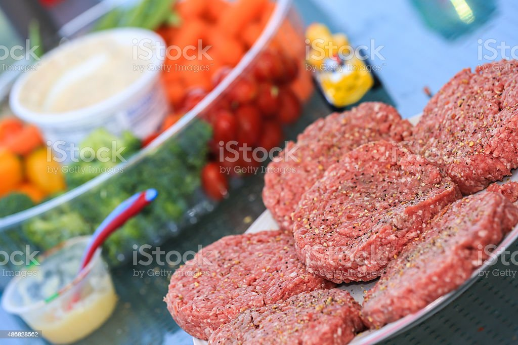 Hamburger Raw Meat Before Cooking on the Barbecue stock photo