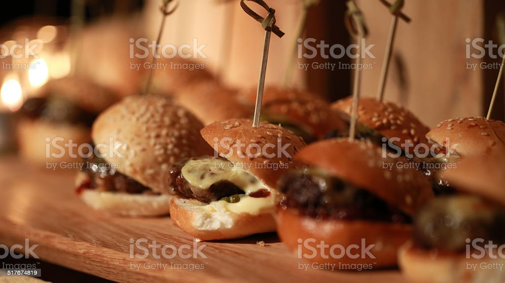 Hamburger slider on a rustic cutting wooden board. stock photo