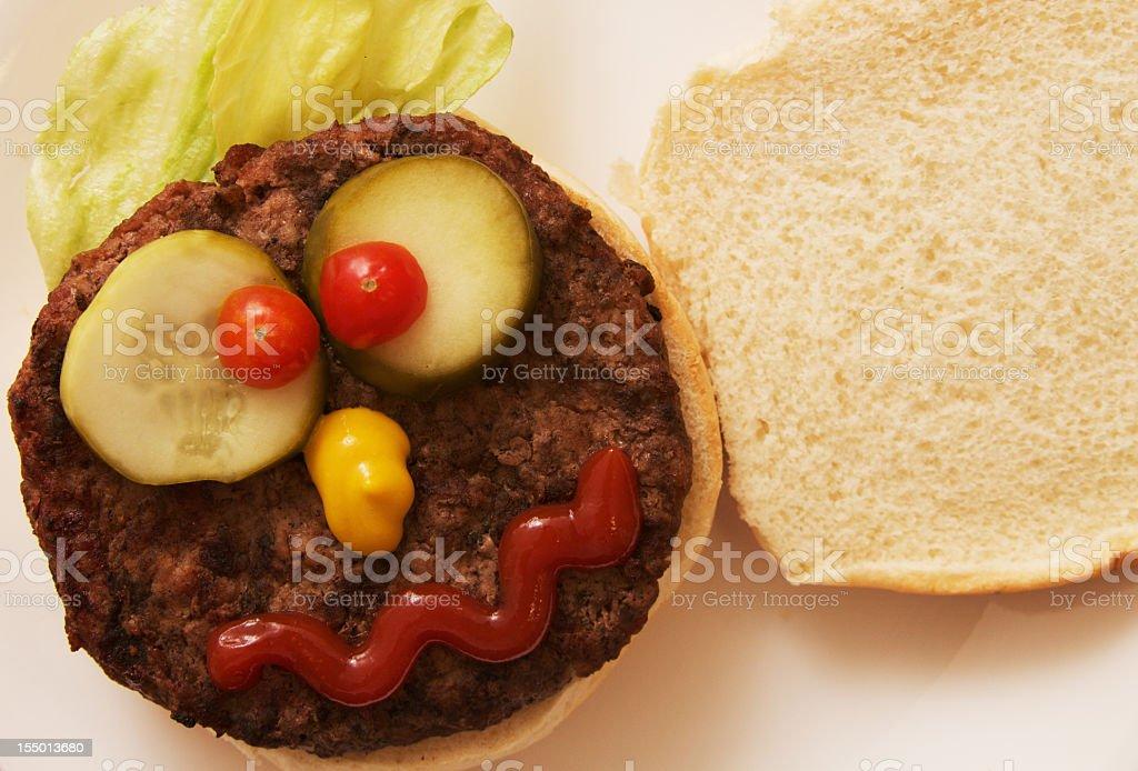 Hamburger with a Funny Face royalty-free stock photo