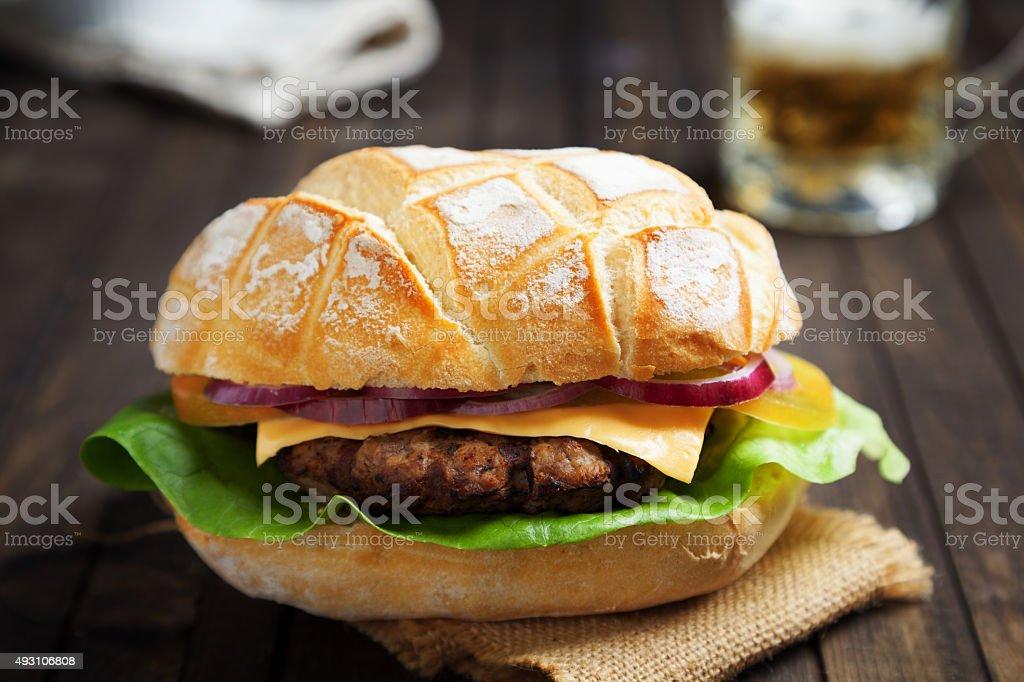 hamburger with cheese tomato salad and onion stock photo