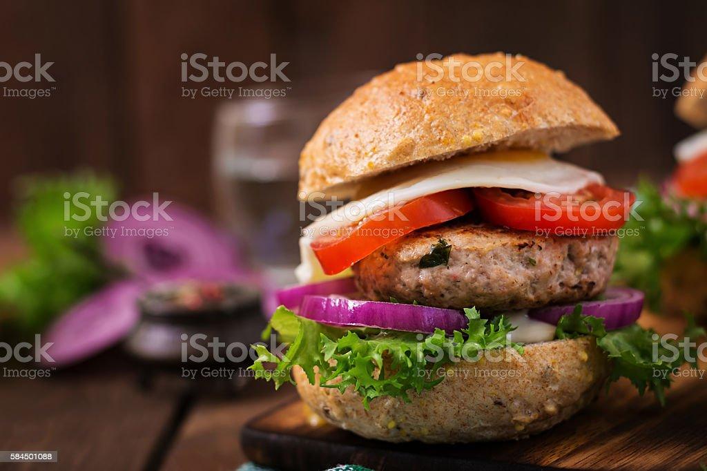 Hamburger (Sandwich) with chicken burger, lettuce, tomato, fried egg stock photo